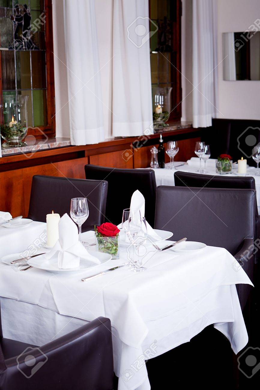 White Tablecloth Restaurant - Stock photo tables in restaurant with white tablecloth and elegant dish and silverwear