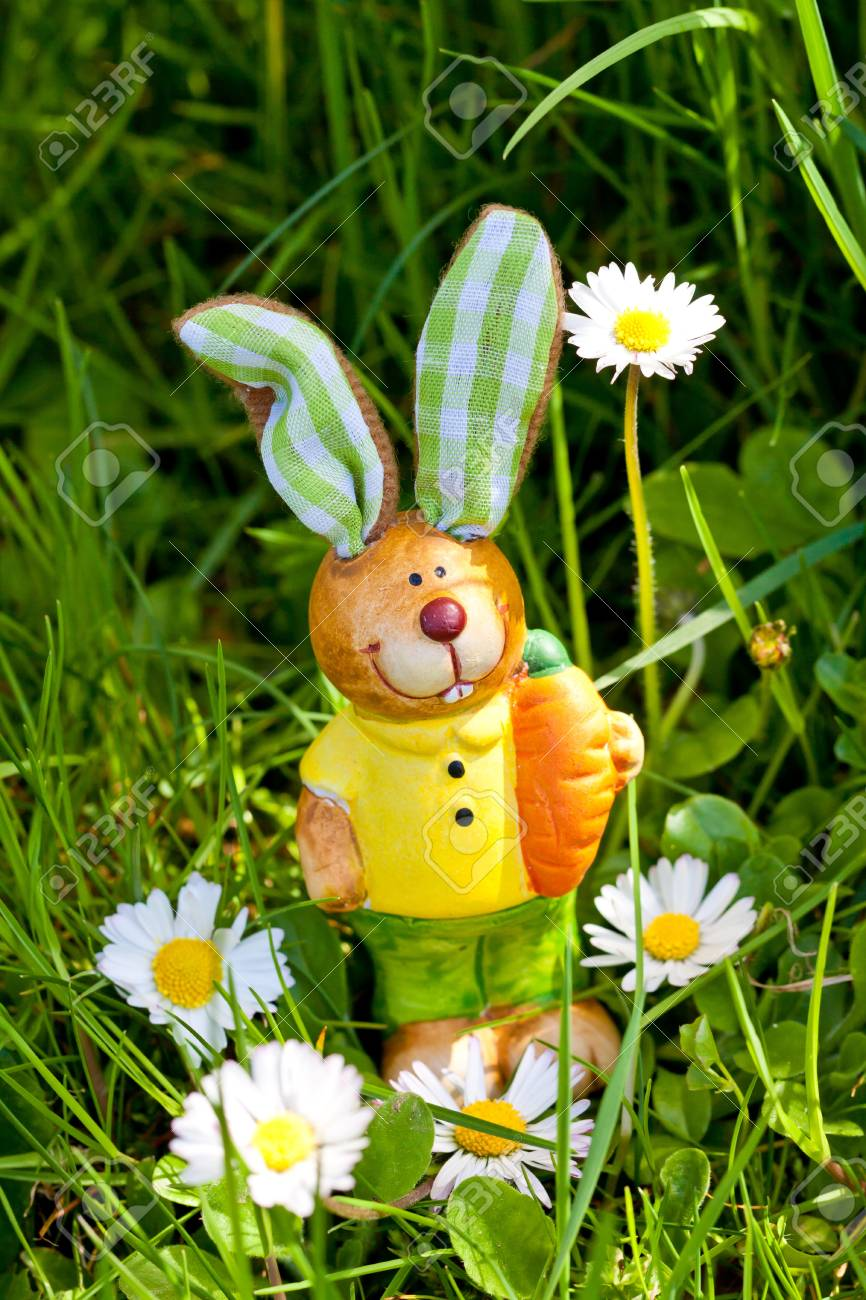 Easter Bunny Decoration Outdoor In Spring In Gras And Flowers Stock