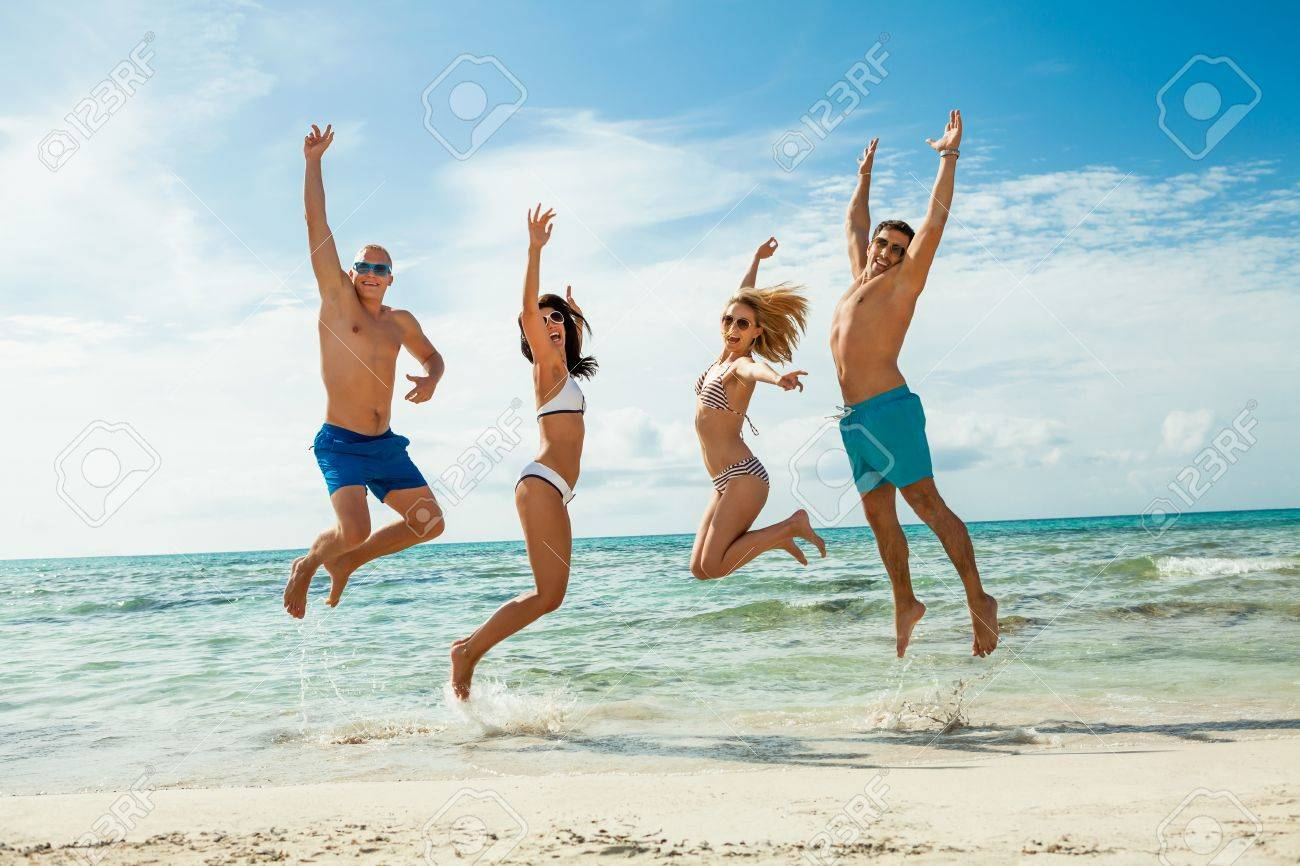 Young Happy Friends Havin Fun On The Beach Summer Holidays Lifestyle Stock Photo