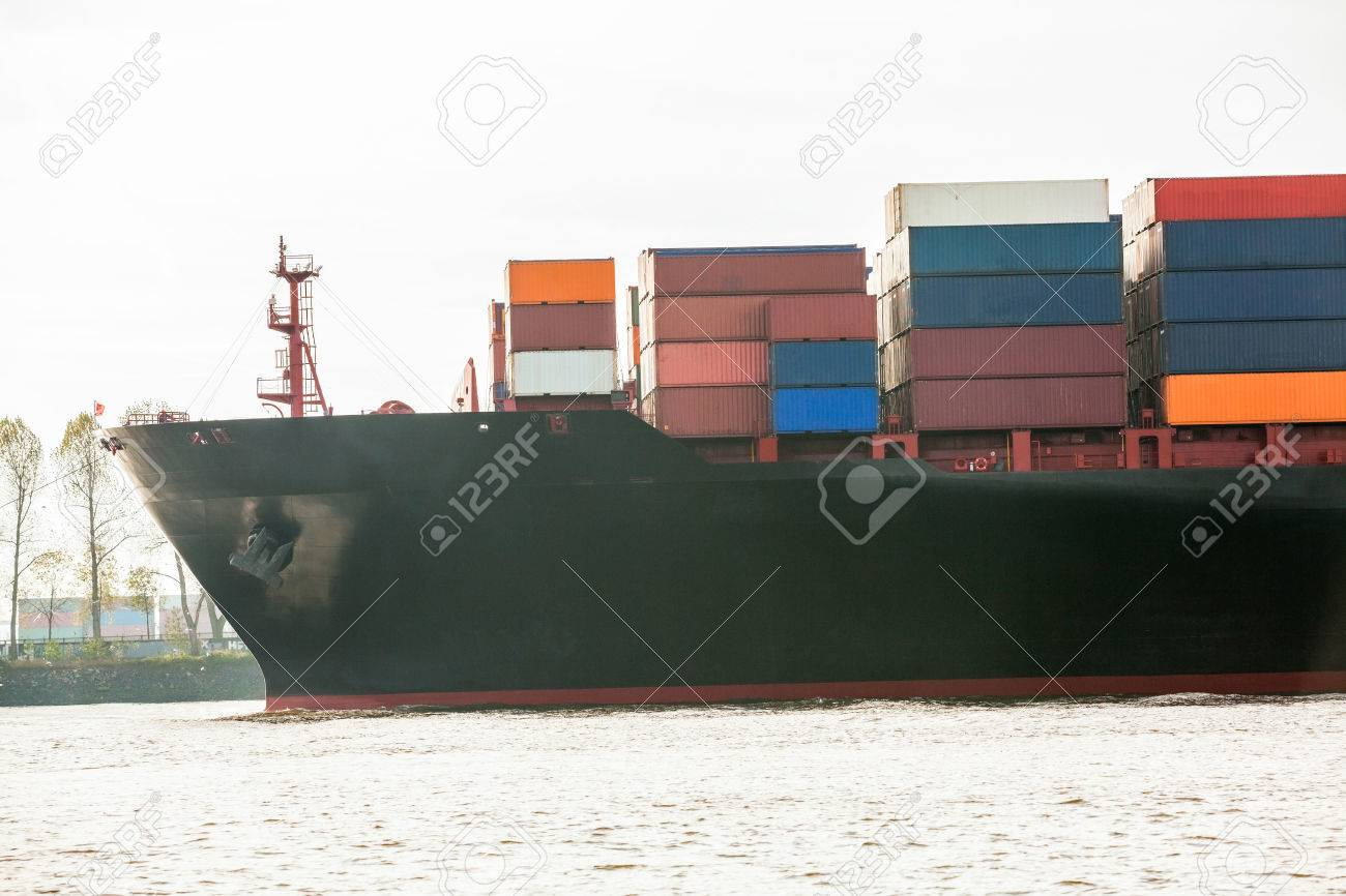 Fully laden container ship in port with its decks stacked with metal containers full of freight and cargo for international destinations Stock Photo - 25587811