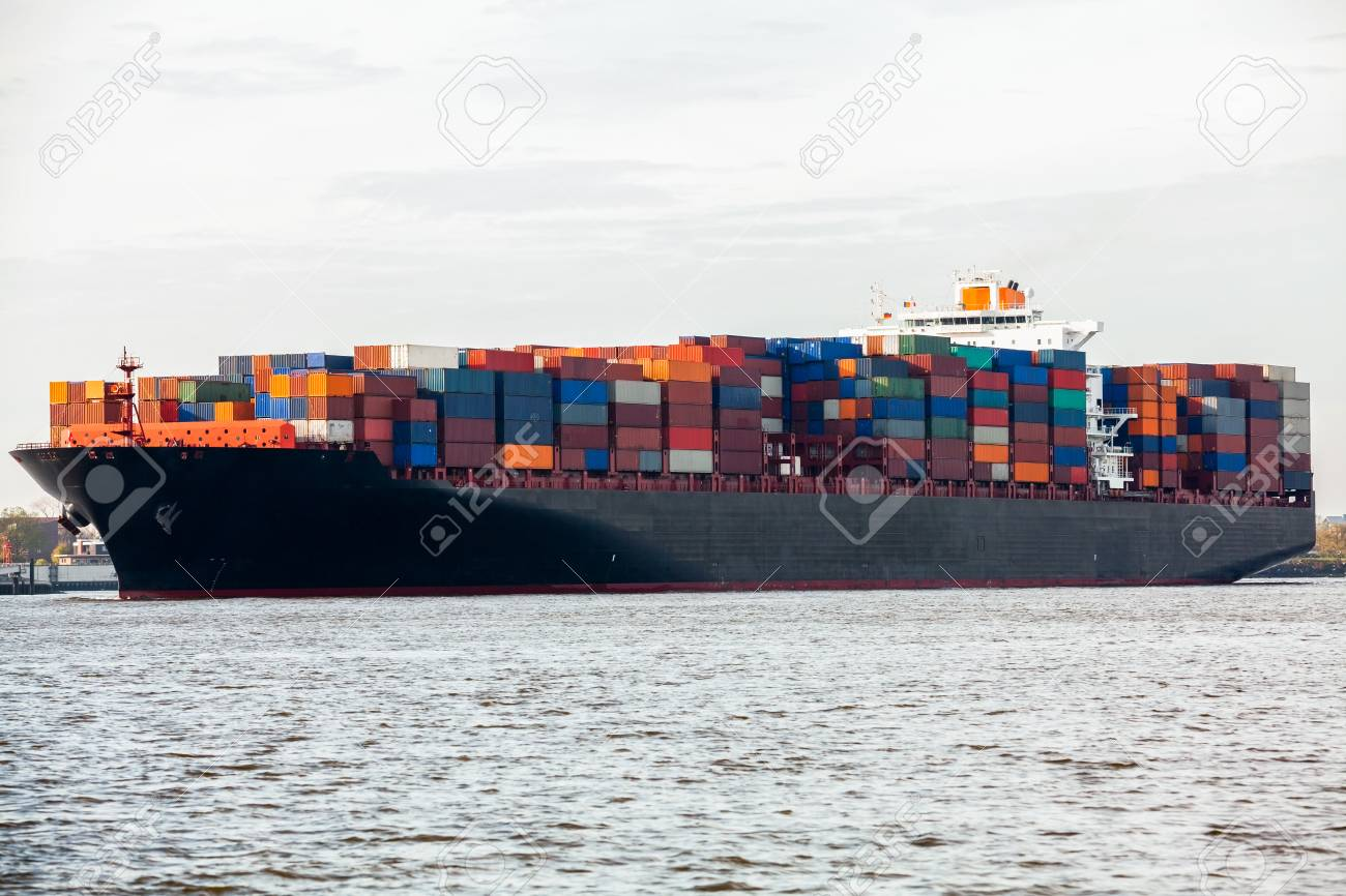 Fully laden container ship in port with its decks stacked with metal containers full of freight and cargo for international destinations Stock Photo - 25976960