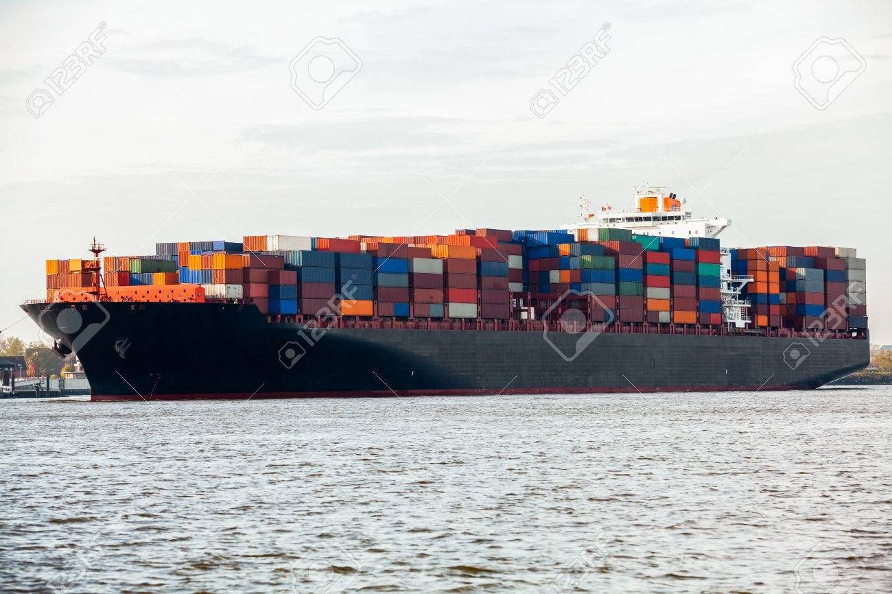Fully laden container ship in port with its decks stacked with metal containers full of freight and cargo for international destinations Stock Photo - 26391562
