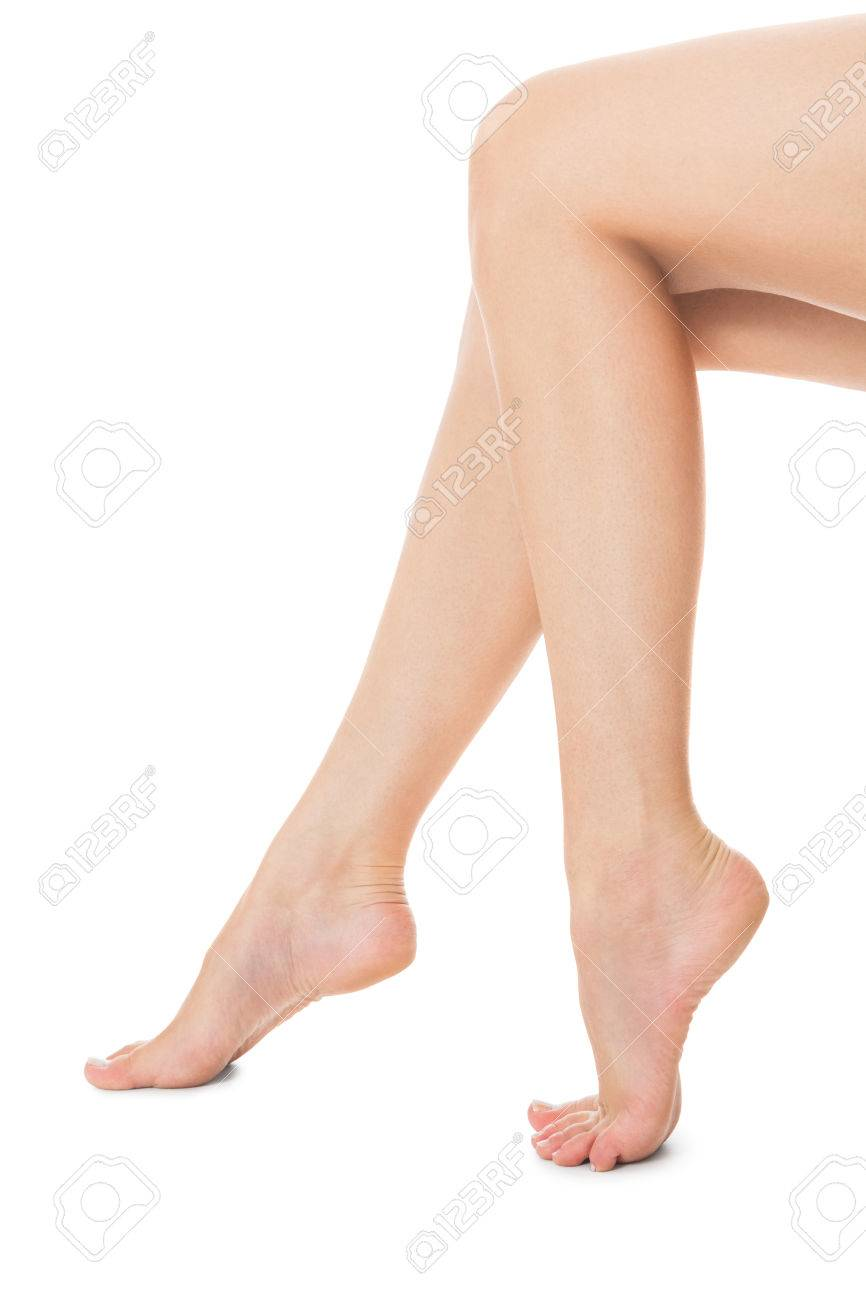 3781473a494792 Photo elegant crossed long bare shapely female legs with bare feet viewed  from above isolated on