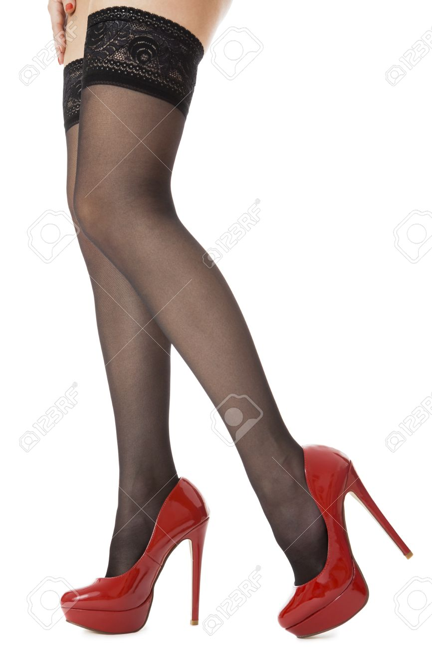 Close Up Sexy Woman Legs Wearing Glossy Red High Heel Shoes And