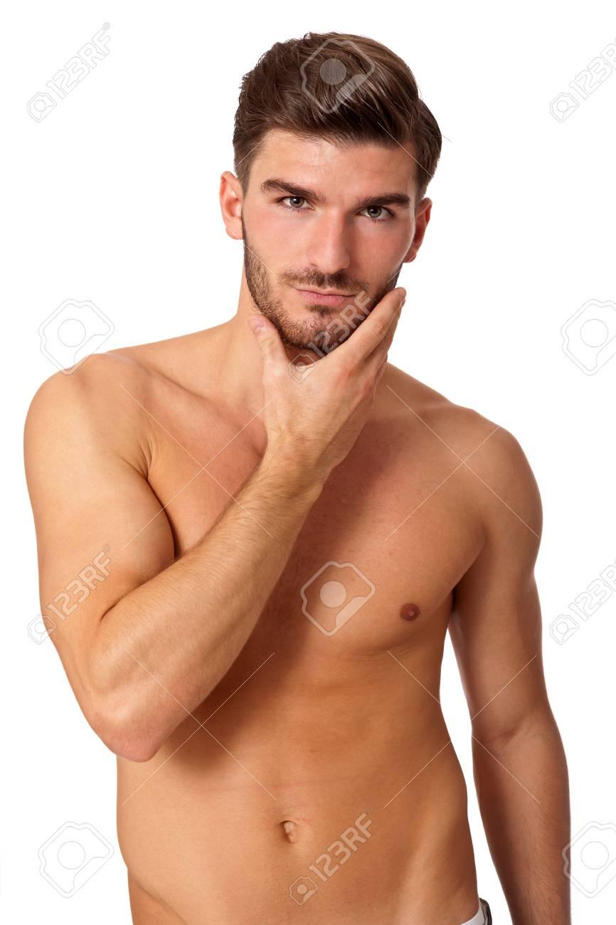 Homme Barbu Nu beau torse nu nu jeune homme barbu debout regardant fixement la
