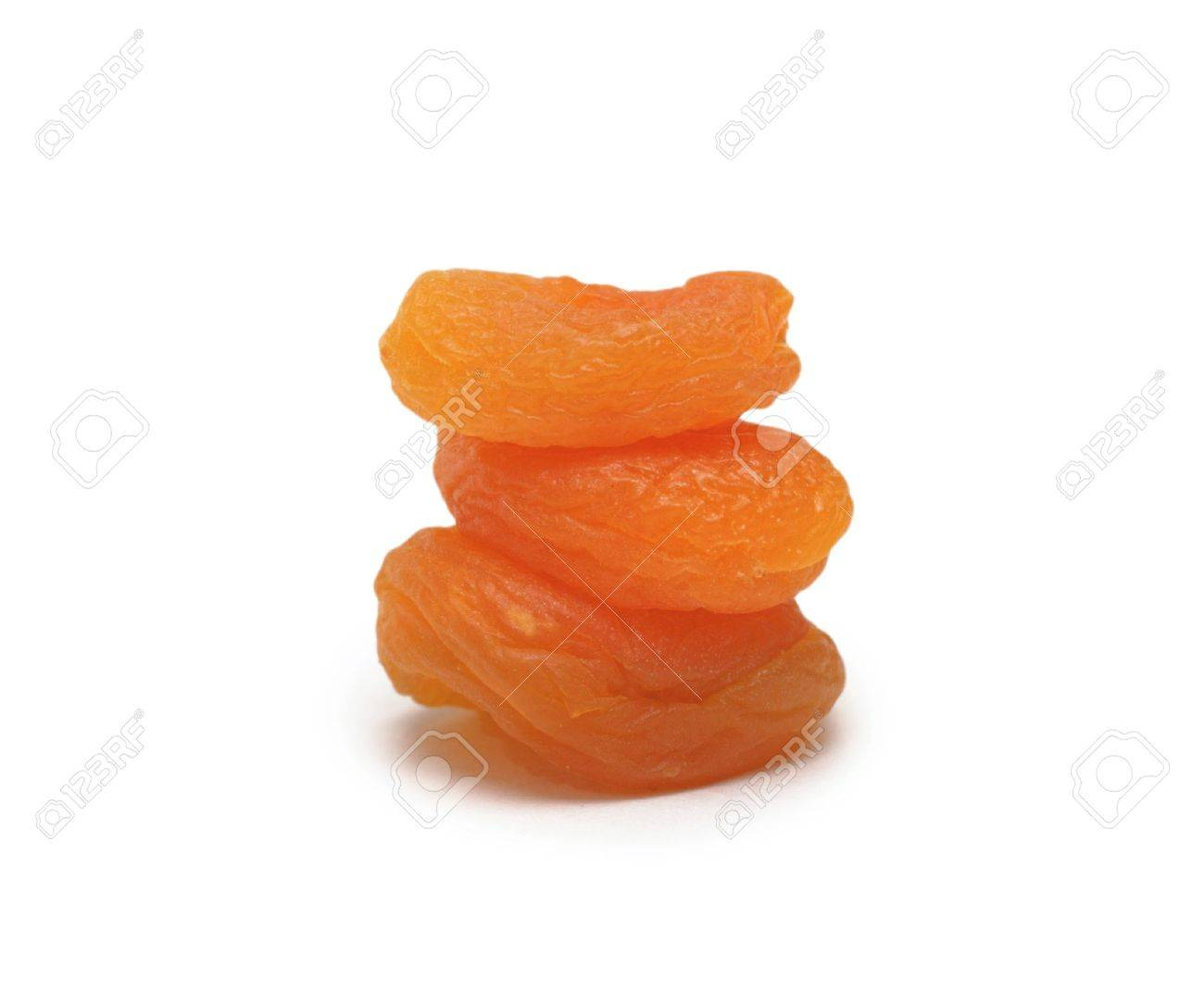 Pile of dried pitted and halved apricot, isolated on white background Stock Photo - 5785641
