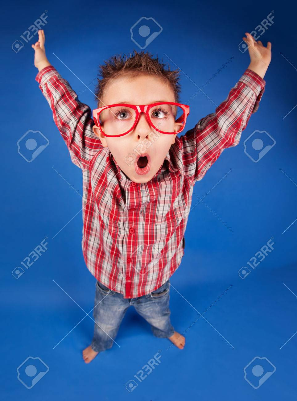 7f9942ce3792 Active funny five years old boy with expressive face, jumping, playing  concept Stock Photo