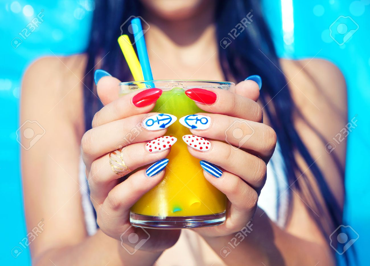 Young Woman With Marine Sailor Manicure Holding Glass Of Orange ...