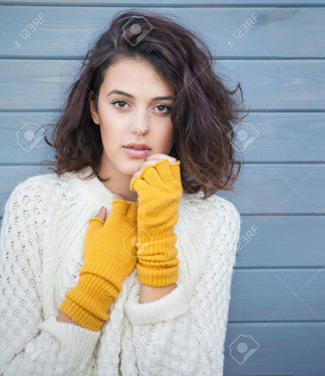 Beautiful natural young brunette woman wearing knitted sweater and gloves. Fall and winter fashion concept. - 45215464