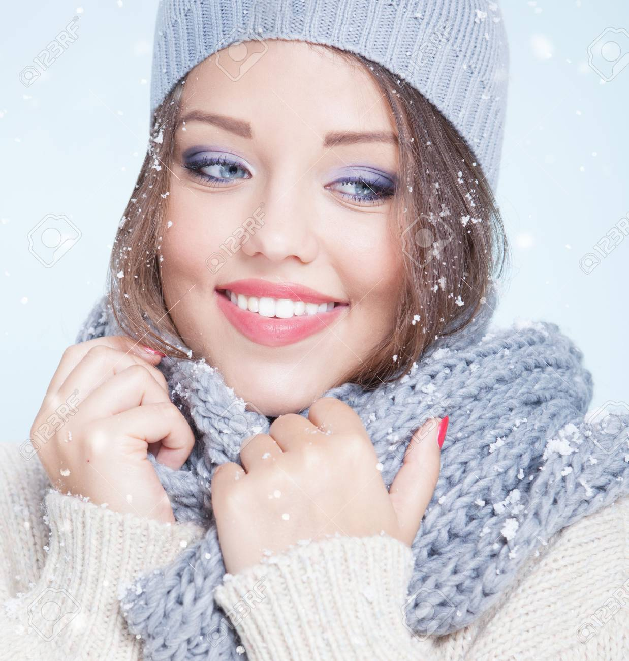 Winter face close up of young attractive happy smiling woman covered with snow flakes. Christmas concept. - 47610262