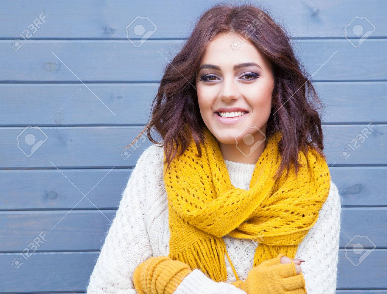 Beautiful natural young smiling brunette woman wearing knitted sweater gloves and scarf. Fall and winter fashion concept. - 48120166