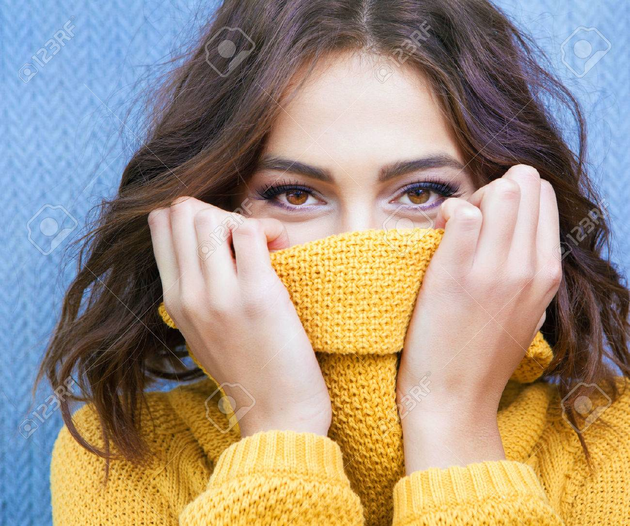 Beautiful natural young shy brunette woman with smiling eyes wearing knitted sweater - 48120175