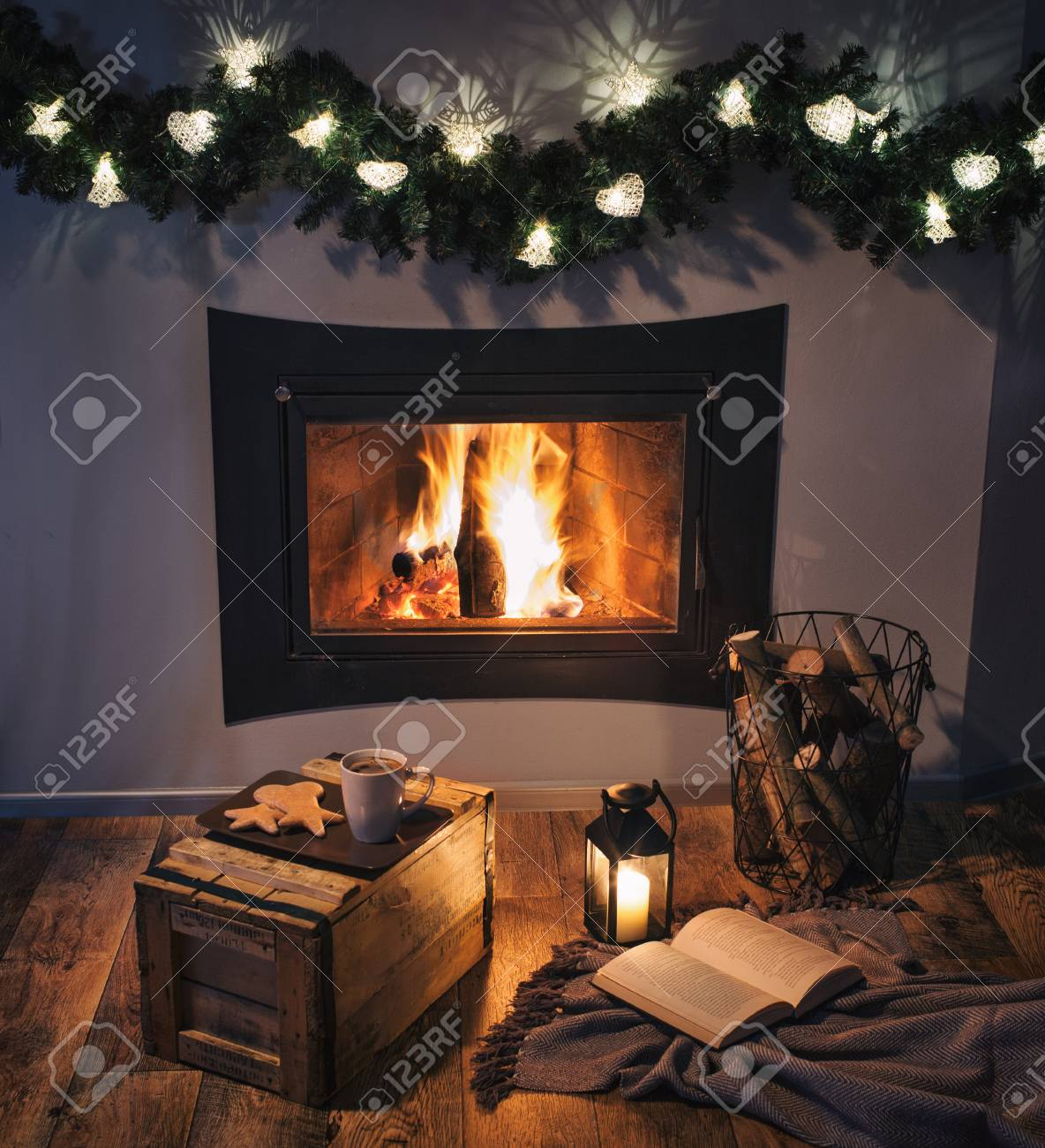 Lights Decorated Fireplace, Lantern, Coffee, Sweets And A Book ...