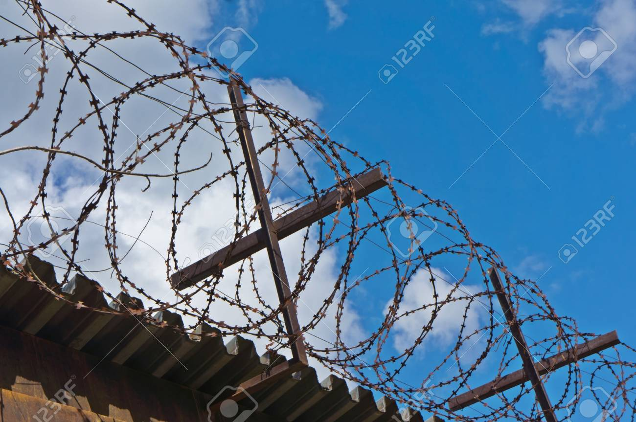 old barbed wire on the wall Stock Photo - 17258484