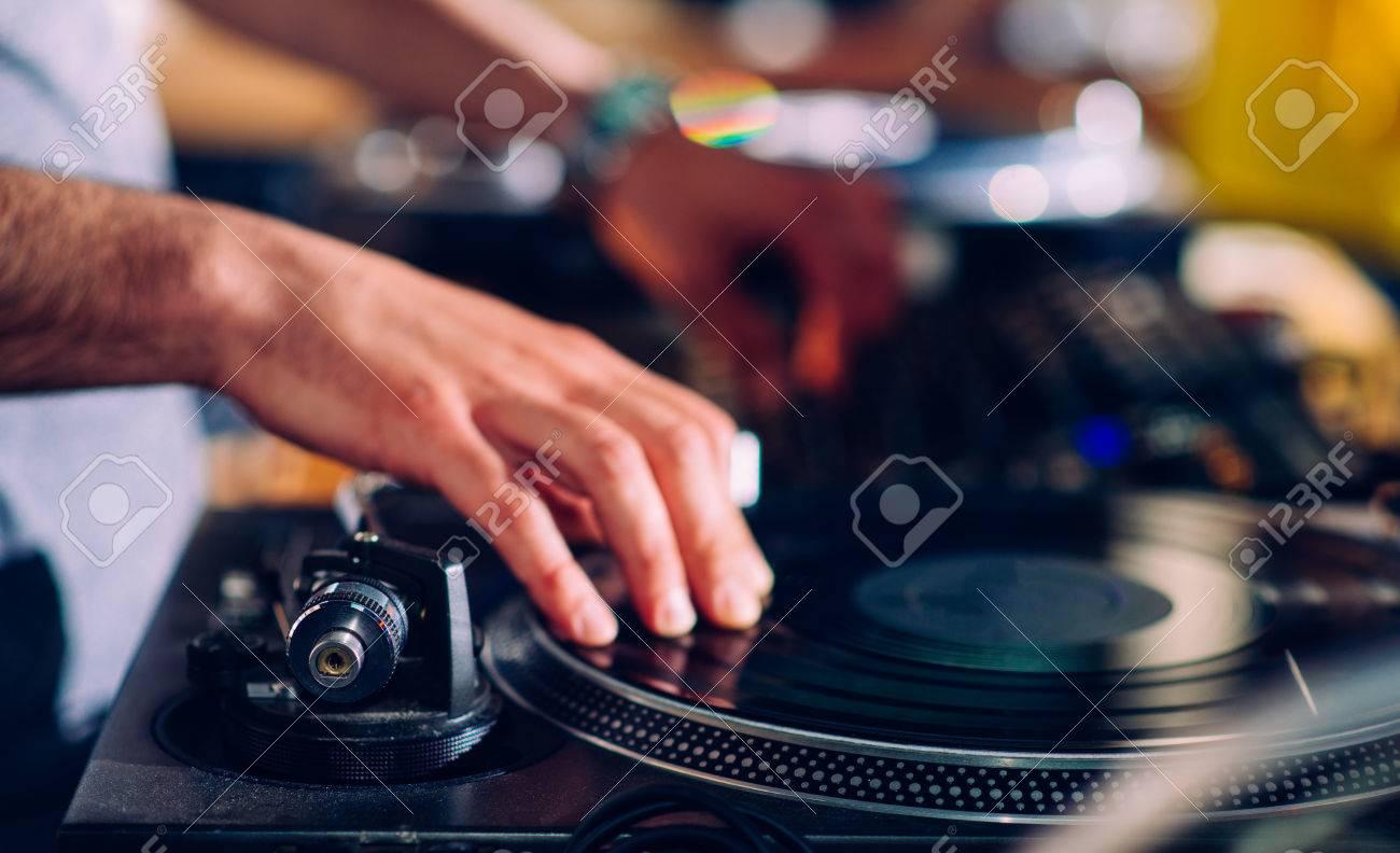 DJs hands on turntable - 29823748