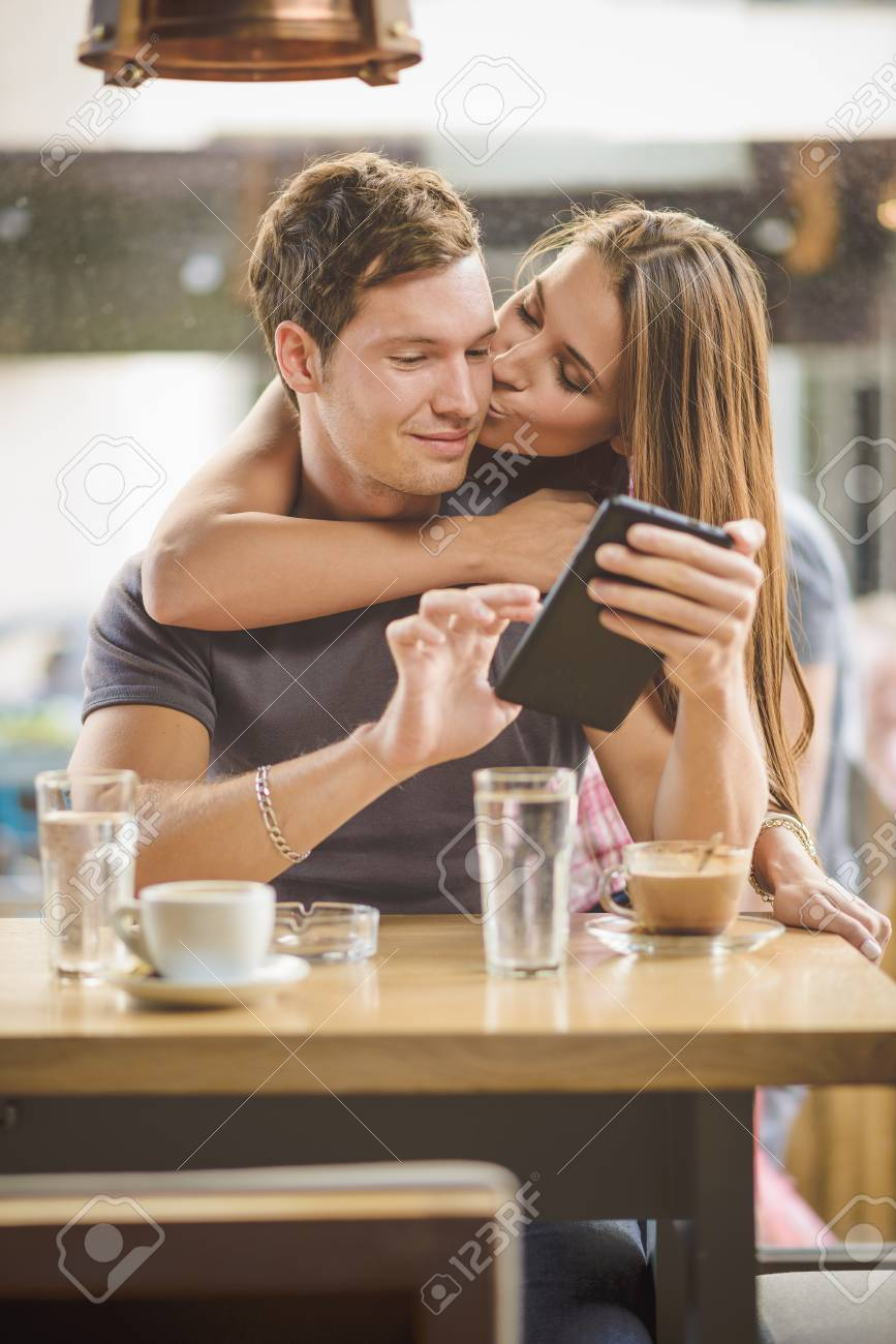 Young couple looking tablet - 32277735