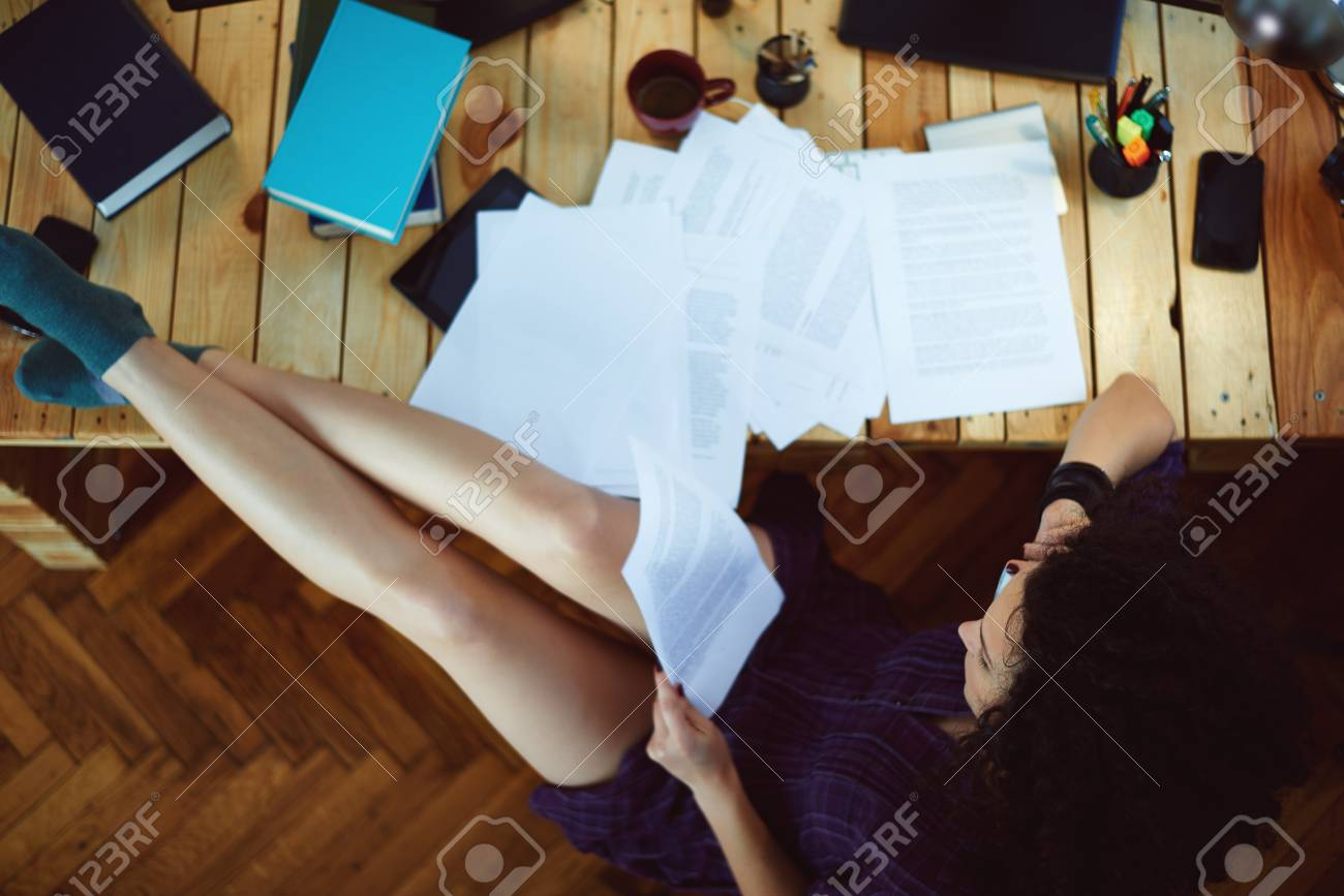 Woman working at home - 34531739