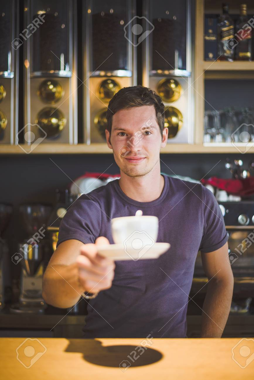Waiter holding coffee cup - 34531856