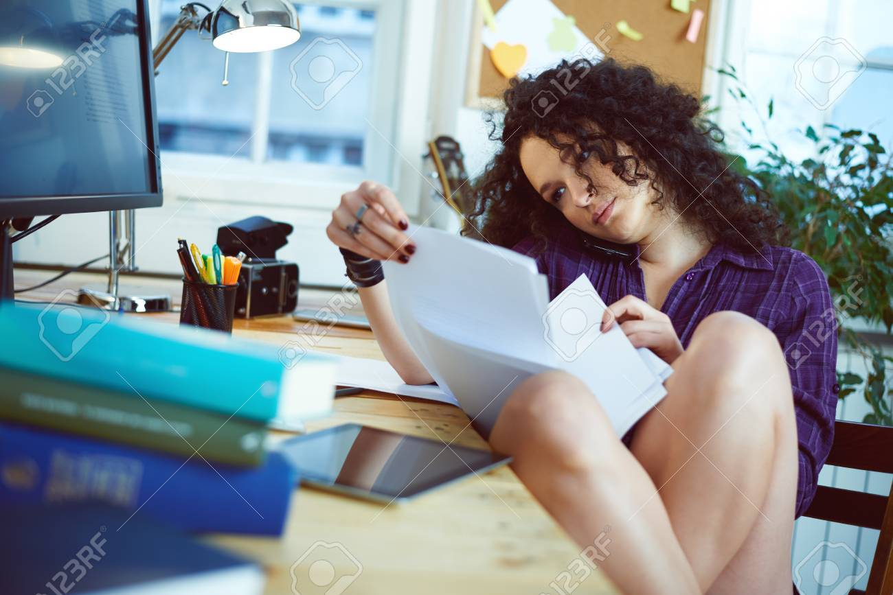 Woman working at home - 35654202