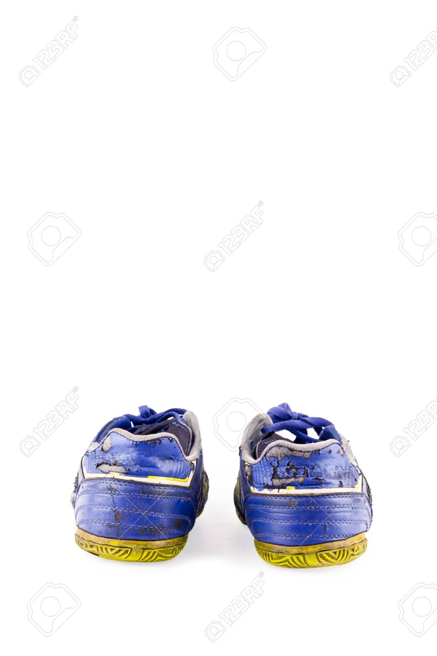 4337e1d2352 Old worn out dirty blue futsal sports shoes on white background football  sportware object isolated Stock
