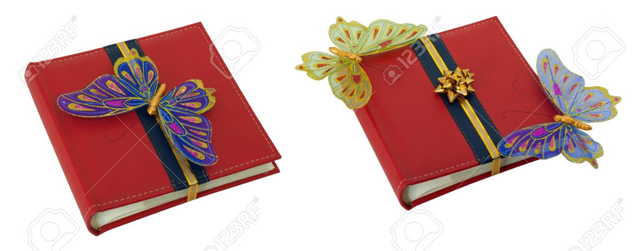 albums for pictures with a gold ribbon and butterflies isolated on white Stock Photo - 9737335
