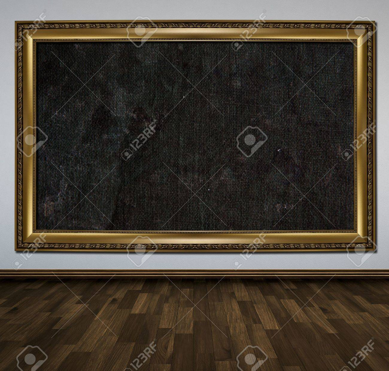 Large gold picture frame hanging on the wall Stock Photo - 10493332