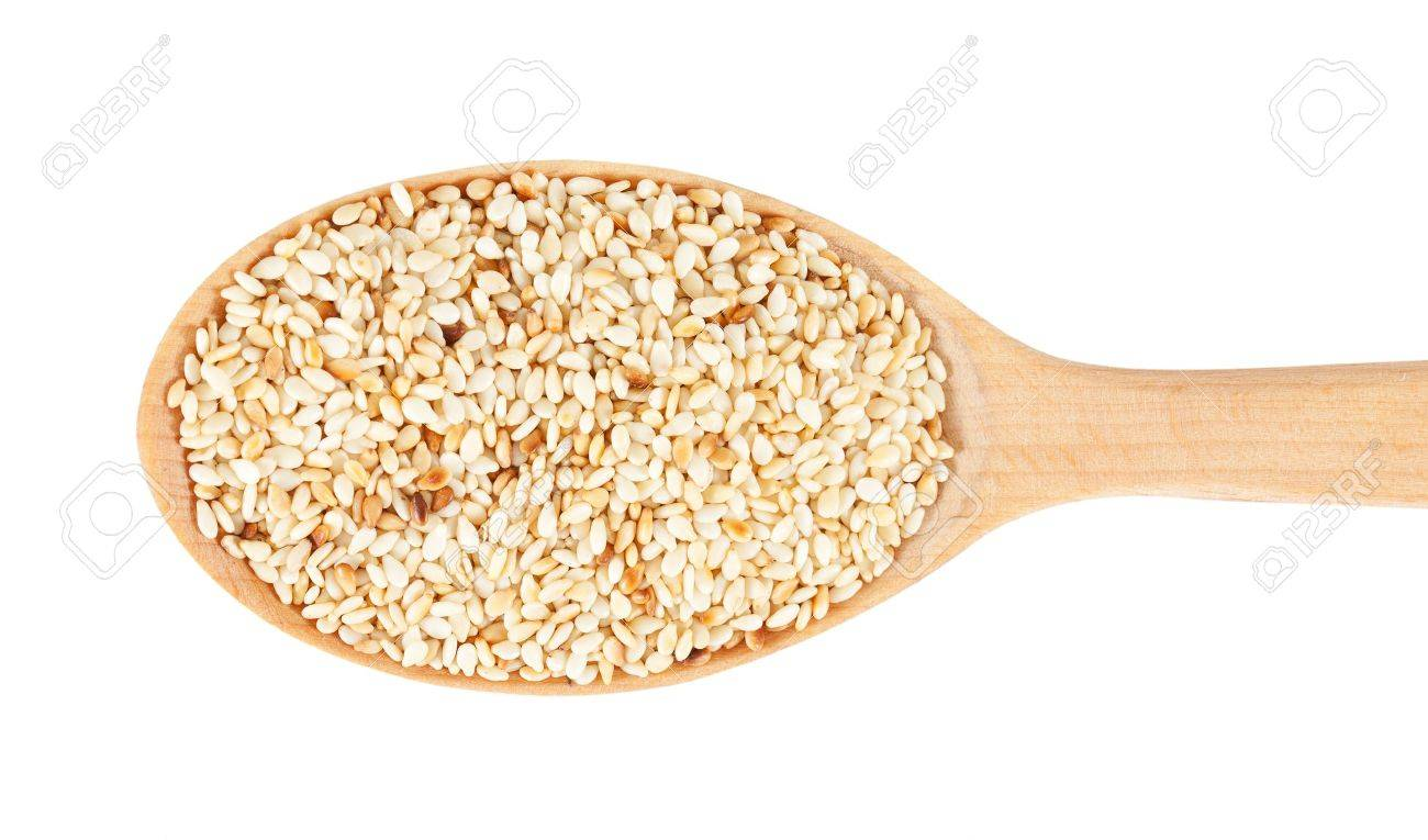 Sesame seeds on wooden spoon. isolated on a white background Stock Photo - 12963568