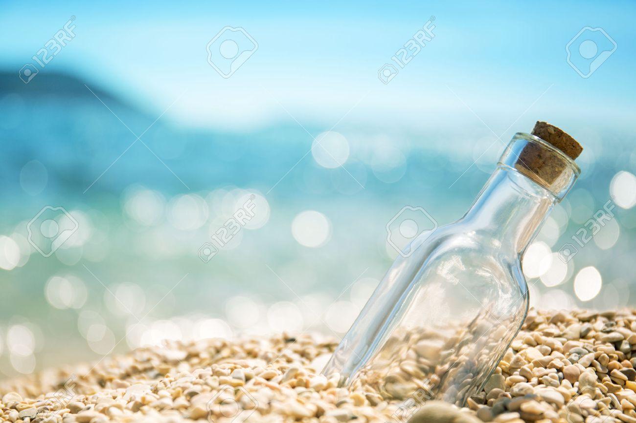 An empty bottle on the seashore - 62156583