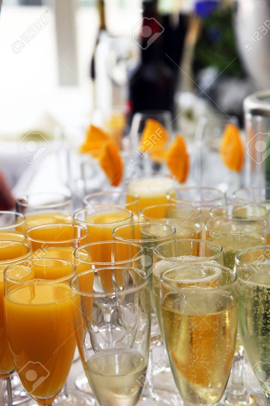 Elegant Flutes Of Champagne And Fresh Orange Juice On A Wedding Buffet Table  Ready For Toasting With Elegant Buffet Table