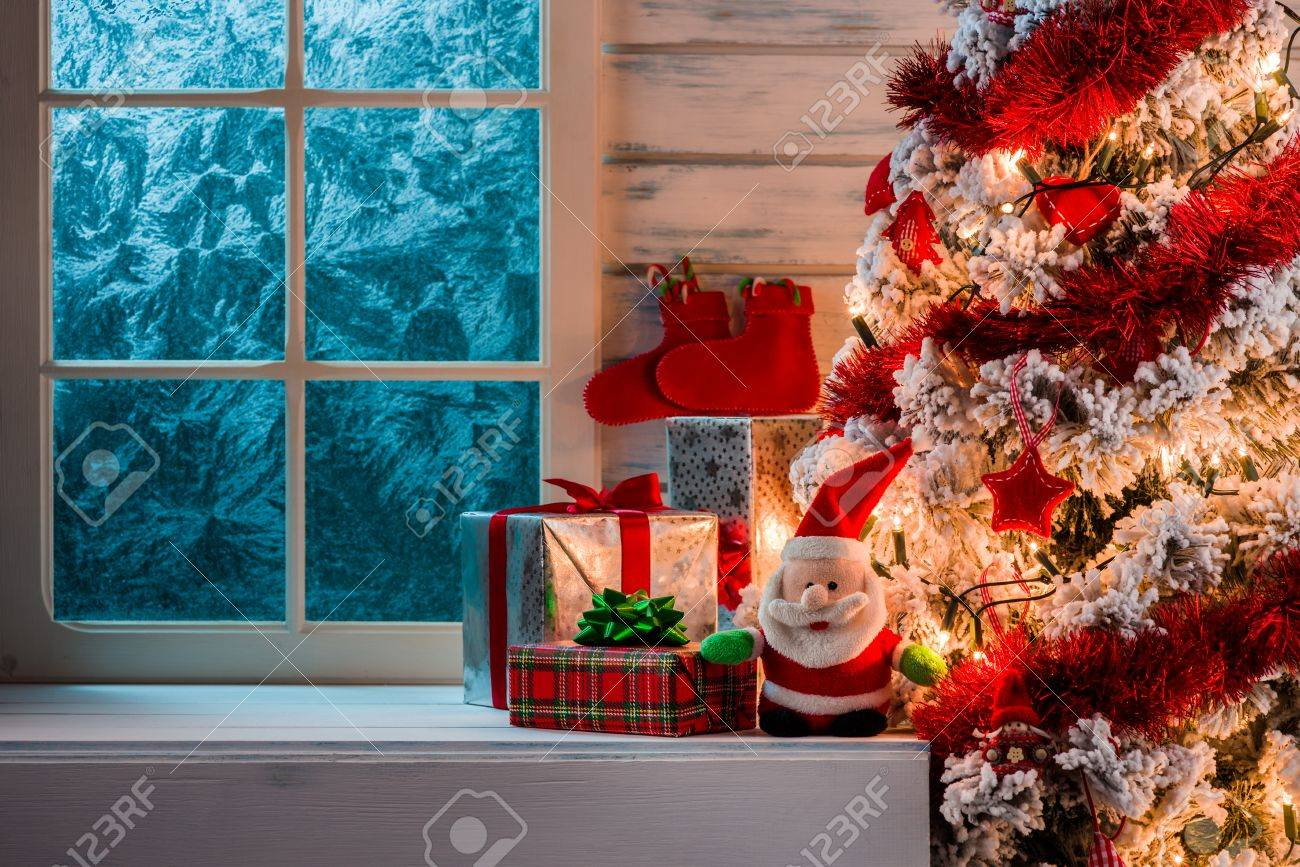 Christmas Scene With Tree Gifts And Frozen Window In Background ...