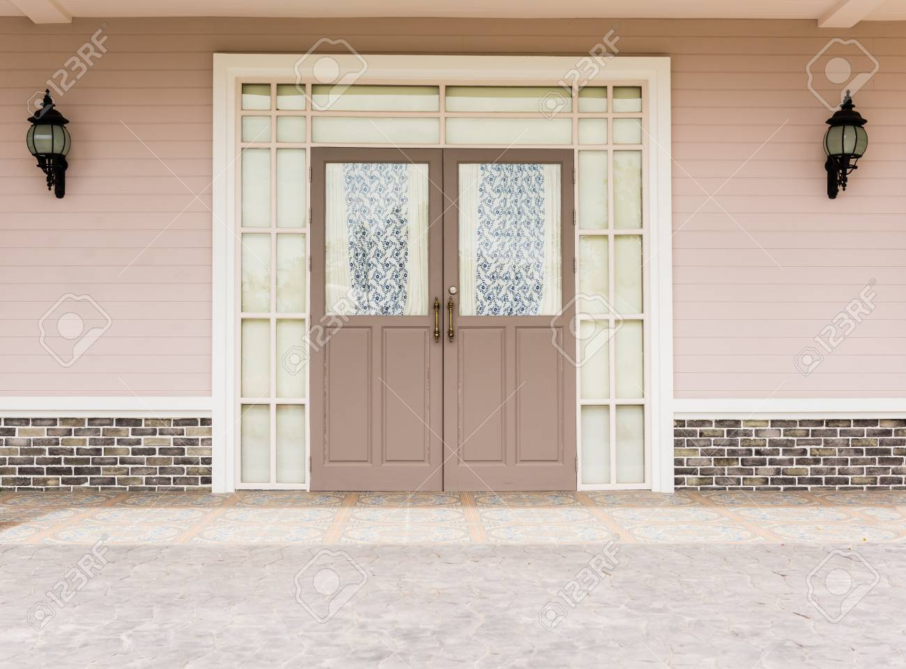 Entrance Vintage House Leading To A Double Glass Paned Front Door With Two  Large Front Lanterns