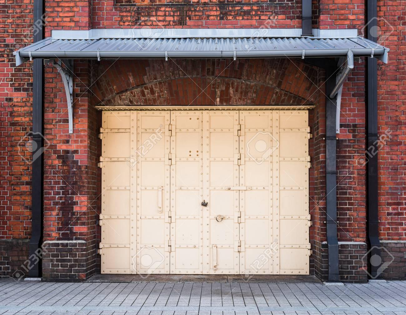 steel Door in a red brick wall background - 35689692