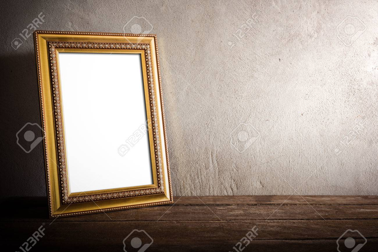 still life of luxurious photo frame on wooden table over grunge background. vintage tone - 38799396