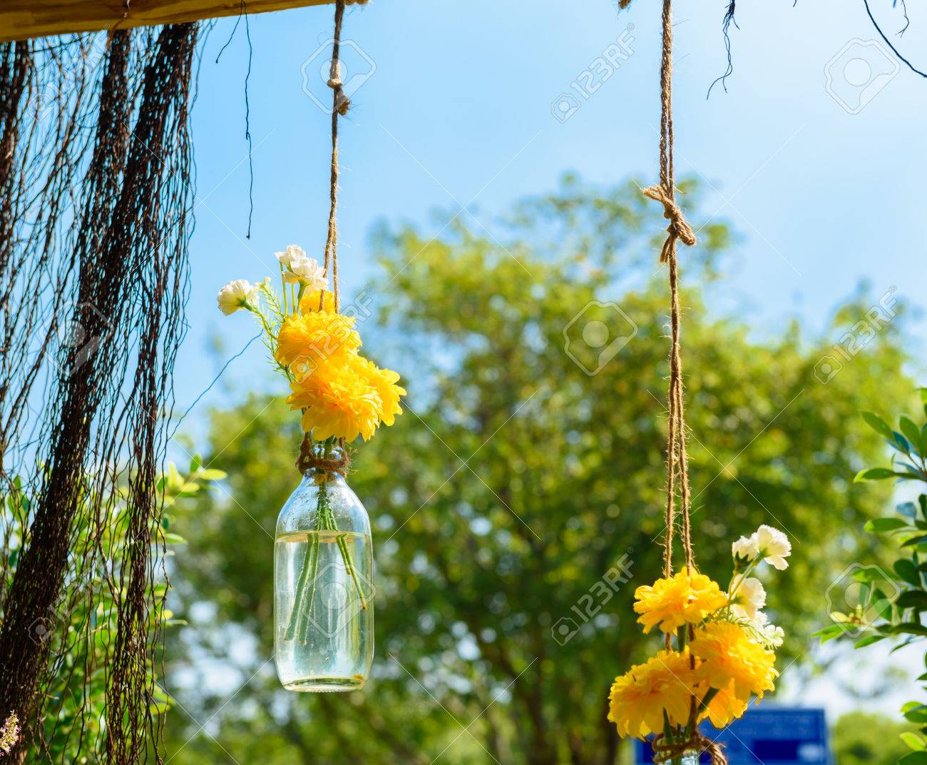 the marigold flowers in a glass bottle hanging flower vase arrangements stock photo 50273512 - Picture Hanging Arrangements