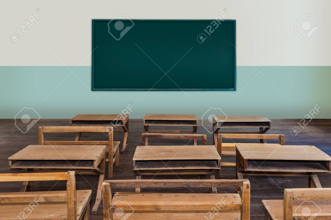 Antique classroom in school with Rows of empty wooden desks,..