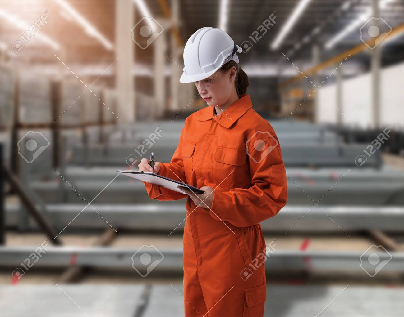 Portrait of Female staff warehouse operator with Blurred the background of Construction material on product shelf in store - 148081570
