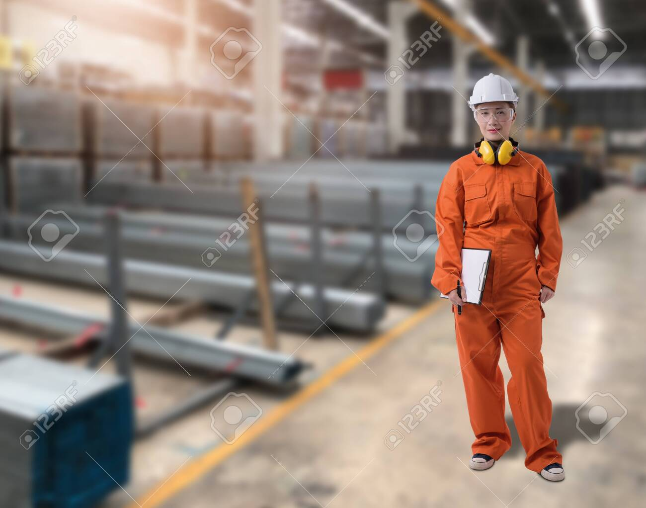 Portrait of Female staff warehouse operator with Blurred the background of Construction material on product shelf in store - 149184546