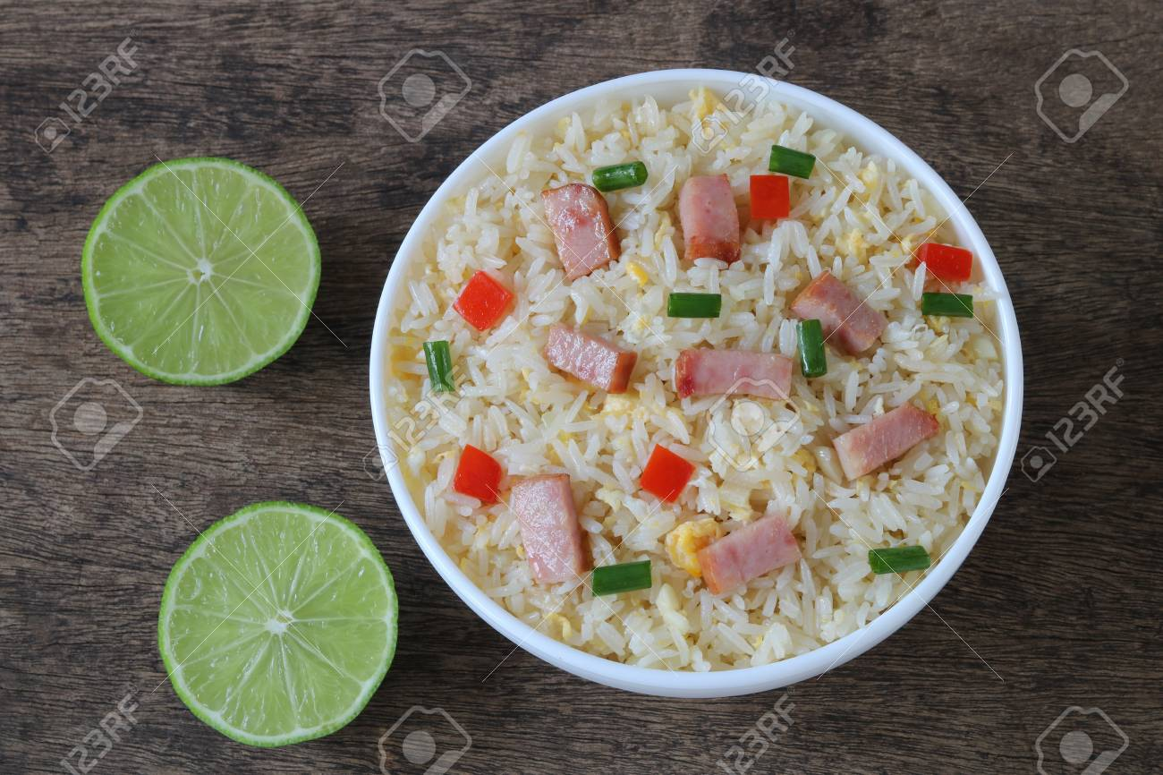 Fried rice with bacon and egg on wooden background - 111229441