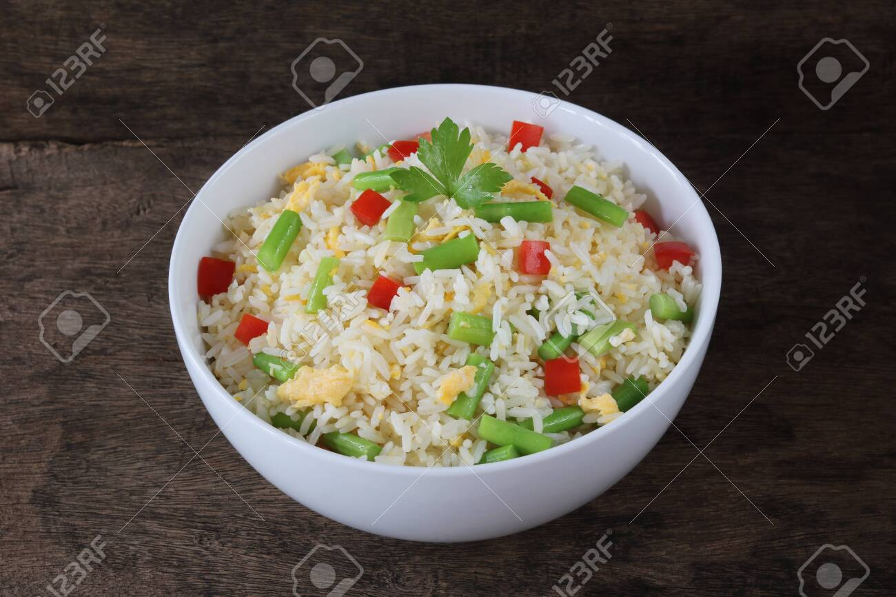 Fried rice with asparagus and egg on wood background - 134729925