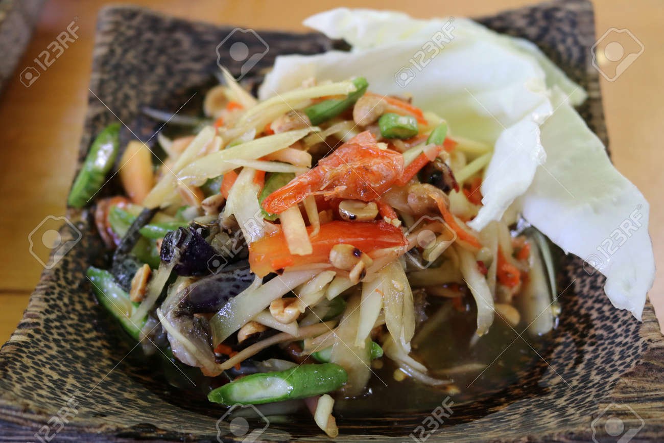 Thai papaya salad ( Som Tum Thai ).Thai style will serve with steamed sticky rice - 155073372