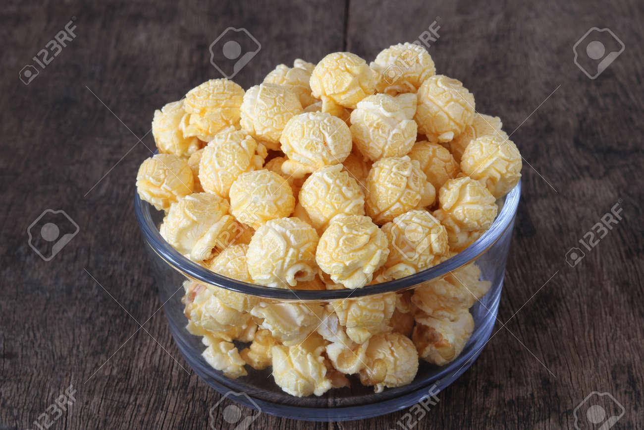 Caramel popcorn on old wood table close up.Sweet popcorn - 155072544
