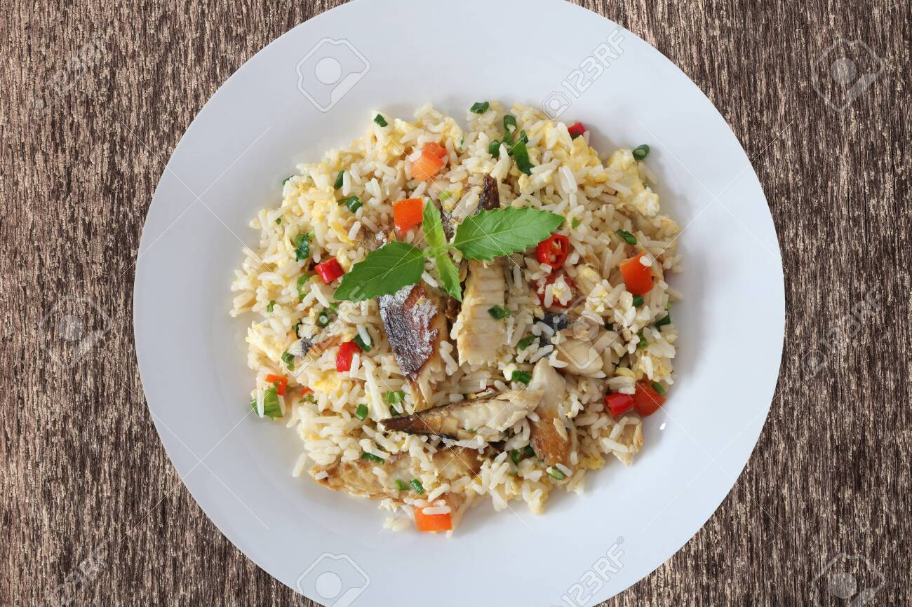 Fried rice with mackerel and egg top view on wood background - 155074880