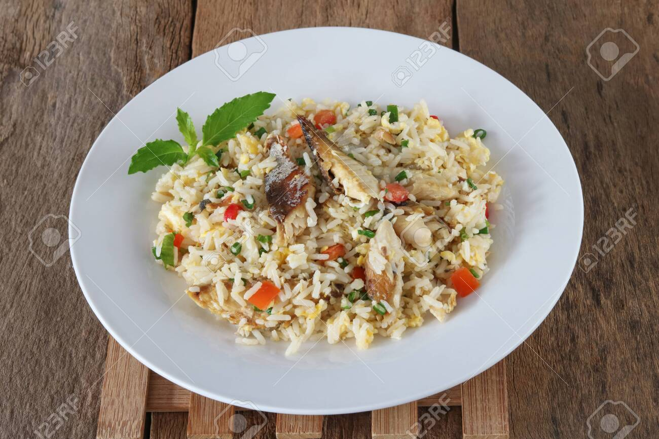 Fried rice with mackerel and egg on wood background - 155074778