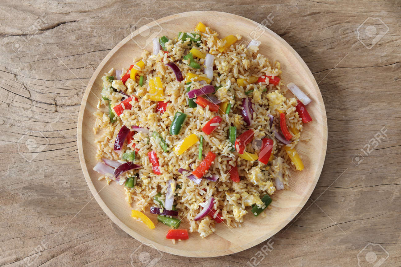 Fried rice with sweet pepper and egg top view .Homemade meal for good health - 157213023