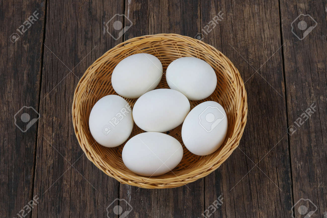 Salted duck eggs in basket on old wooden background. - 158834377