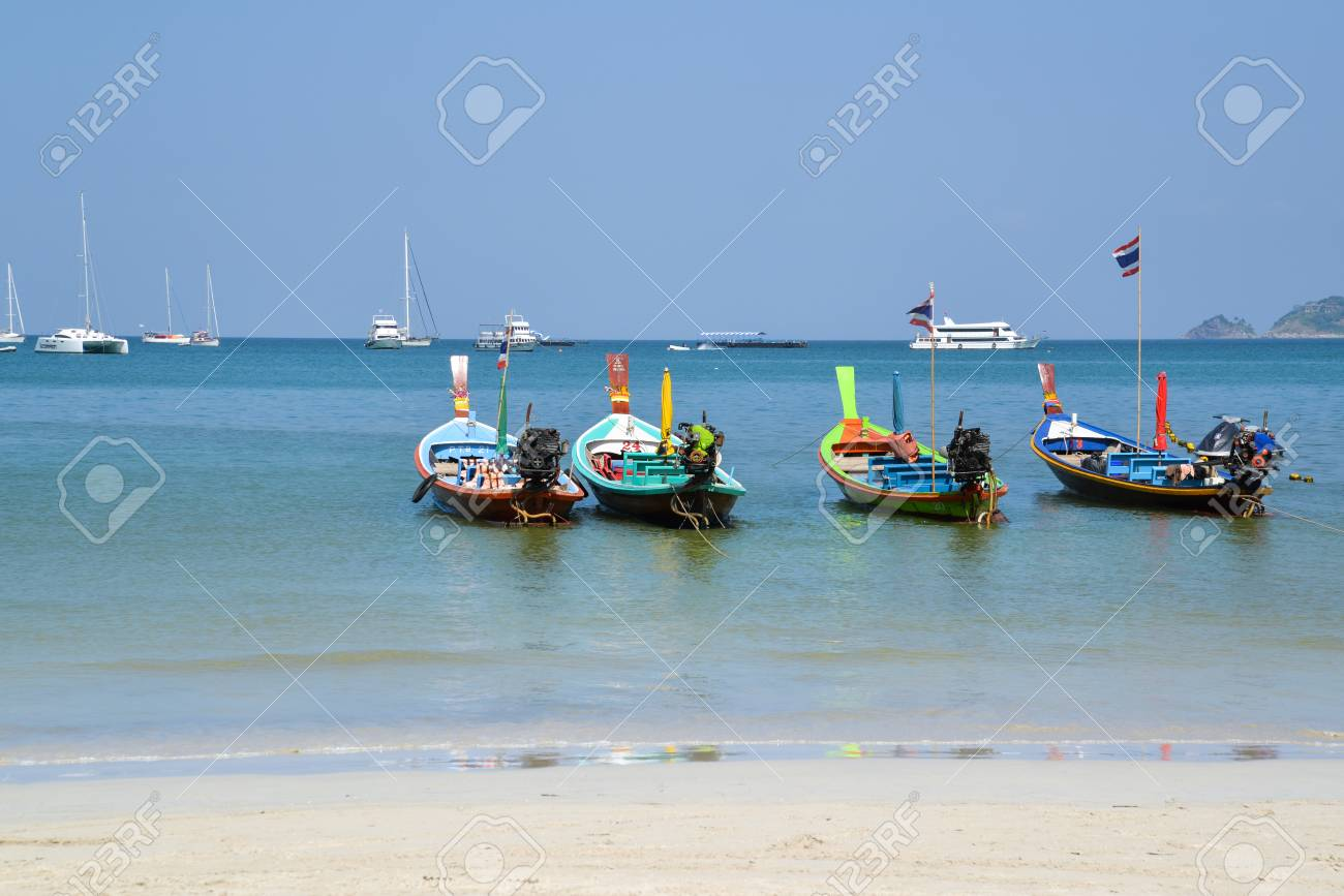 Long tail boat is waiting for tourists for day tour at Patong