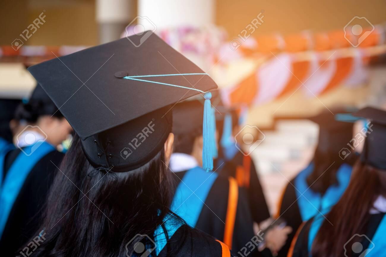 Graduates wear black hats, black hats.Graduates join the graduation ceremony at the university. - 121332148