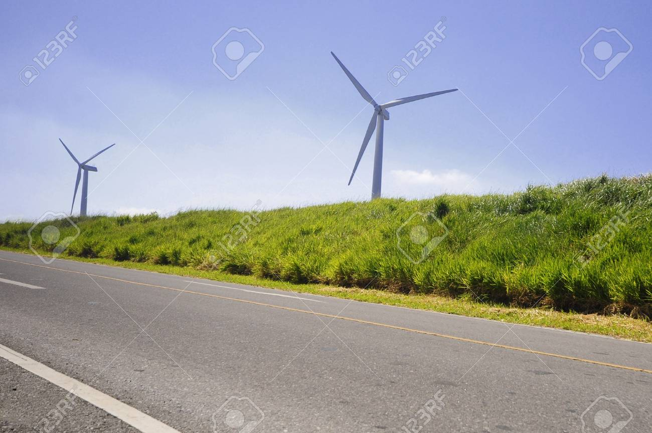 Wind power station - wind turbine against the blue sky Stock Photo - 13342984