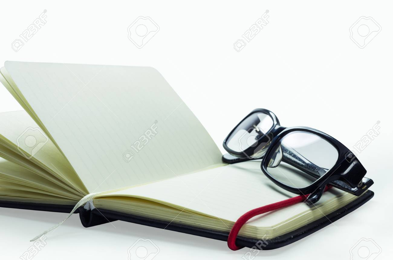 bead024074 Black Frame Glasses On The Notebook
