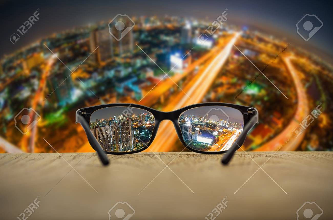 330808bf96 Clear cityscape focused in glasses lenses with blurred cityscape  background. Stock Photo - 72395392